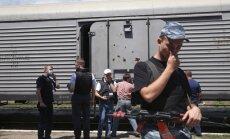 ESBO ekspertai tikrina traukinį, į kurį sukrauti numušto Malaizijos lėktuvo žuvusiųjų kūnai, Ukraina