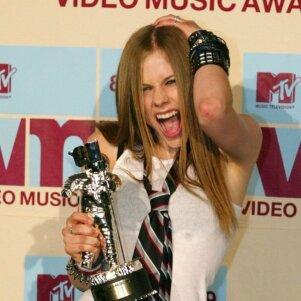 Avril Lavigne - jau nebe smilgelė maištininkė (FOTO)