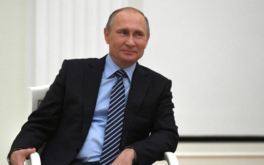 """Путин назвал Кастро """"искренним и надежным другом"""""""