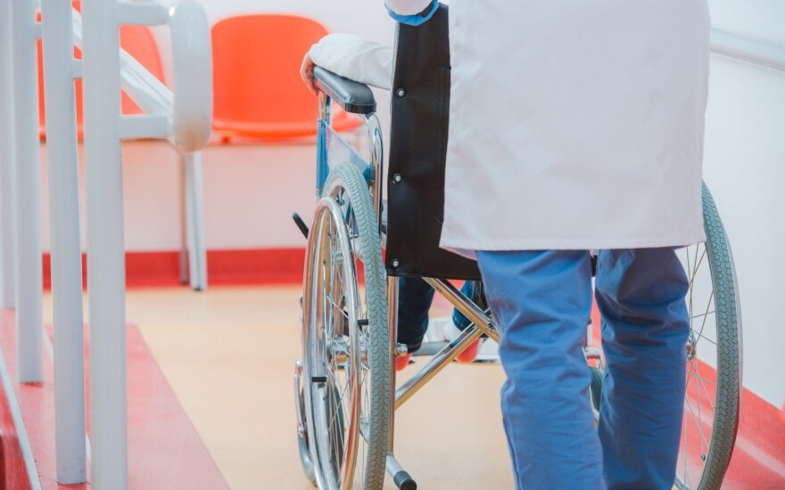 Vaikas vežimėlyje
