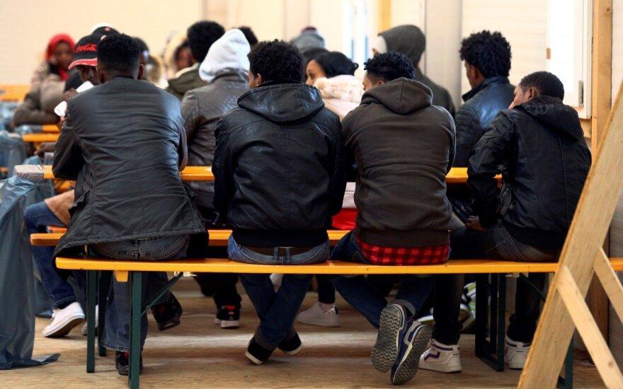 """В ФРГ """"большая коалиция"""" достигла договоренностей по беженцам"""