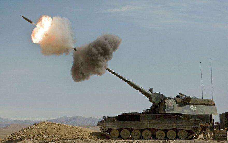 """Dutch Panzerhaubitz fires in Afghanistan"" by Ministerie van Defensie"