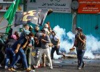 Ašarinių dujų granatos Bagdade pražudė 3 protestuotojus