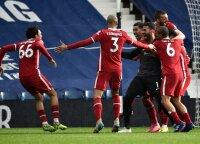 """Stebuklingas """"Liverpool"""" triumfas: paskutinę akimirką pergalę išplėšė vartininko pelnytas įvartis"""