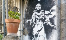 Banksy Madonna su pistoletu