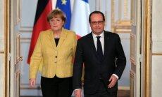 A.Merkel, F. Hollande'as