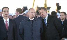 Vladimiras Putinas ir Aleksejus Mileris (dešinėje)