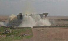"""Irakiečiai stumia """"Islamo valstybės"""" teroristus, sprogdina jų namus, iškasa kapus"""
