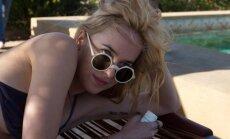 Kadras iš filmo Didesni purslai, Dakota Johnson