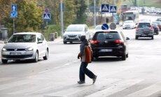 Per gatvę einantis vaikas