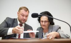 Jadvyga Daktarienė ir advokato padėjėjas Ramūnas Putinas