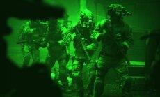 Kadras iš filmo Zero Dark Thirty: JAV karinio jūrų laivyno specialiųjų pajėgų SEAL 6-osios komandos nariai šturmuoja Osamos Bin Ladeno namus