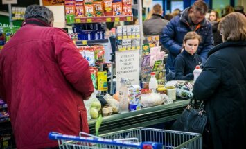 What do experts think is behind rising prices in Lithuania?