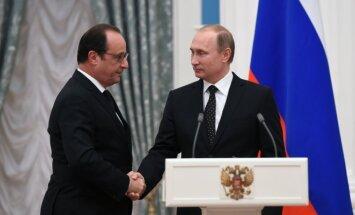 Francois Hollande'as ir Vladimiras Putinas