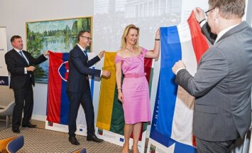 FLTR,Ambassador Peter Hatiar, Political Director Rolandas Kačinskas, Žaneta Fomova and Ambassador, Bert van der Lingen  36 Photo © Ludo Segers @ The Lithuania Tribune