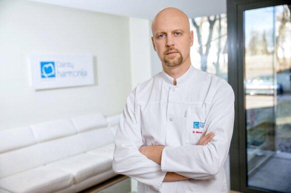 Implantuojantis gydytojas Marius Bučinskas