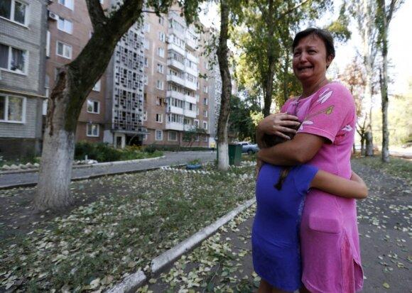 Siaubas Rytų Ukrainoje: išėjusi iš parduotuvės mama pamatė 10 lavonų