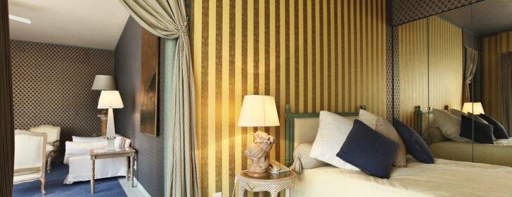 Interjero idėjos: dryžuotas miegamasis