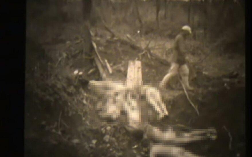 """Karo grimasos: paviešinta šokiruojanti medžiaga apie """"guodėjas"""""""