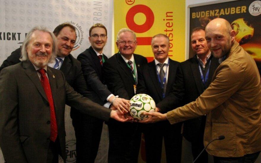 Robertas Tautkus, Edvinas Eimontas ir Julius Kvedaras su kolegomis iš Vokietijos  (shfv-kiel.de nuotr.)