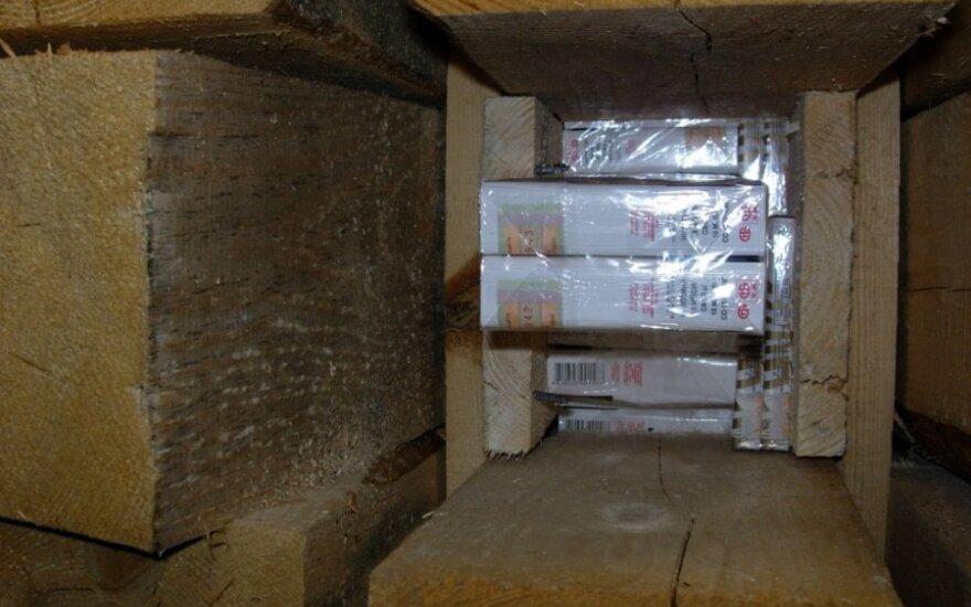 Baltarusiška mediena - prasta slėptuvė milijonais vertinamai kontrabandai