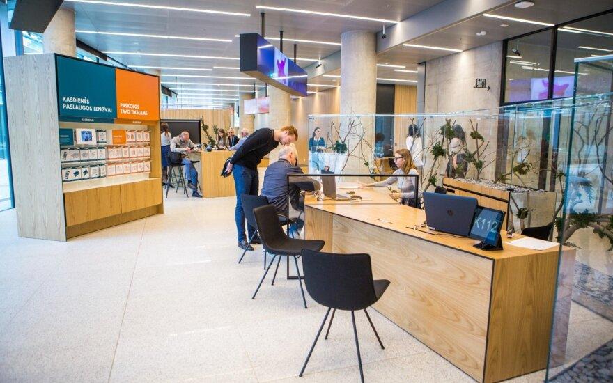 Išvengti eilių bankuose kviečia registruojantis iš anksto
