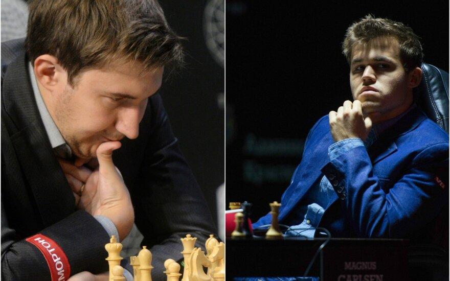 Sergejus Kariakinas (kairėje) ir Magnusas Carlsenas (RIA ir AP nuotr.)