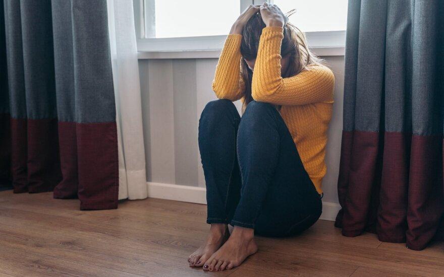 Moteris, patirianti smurtą