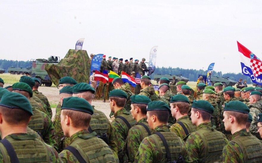 """Lietuvos kariai grįžta iš tarptautinių pratybų """"Anakonda 2016"""""""