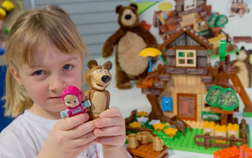 A girl with dolls from the Masha and the bear animation
