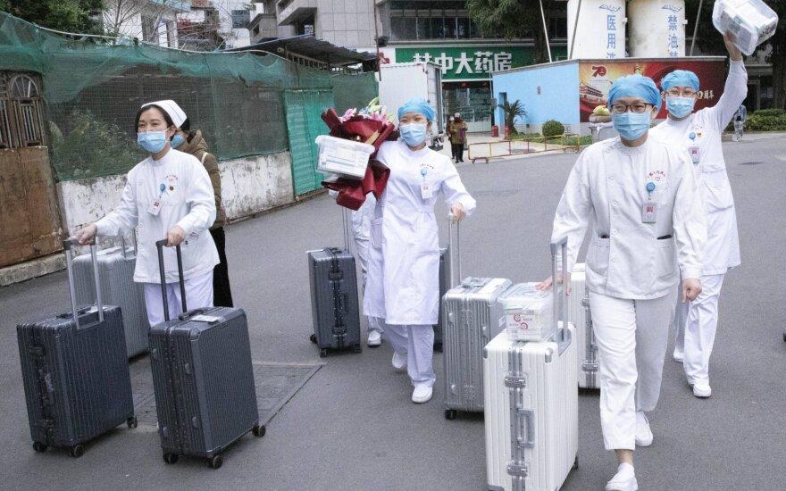 JAV ragina Kiniją labiau bendradarbiauti koronaviruso klausimu