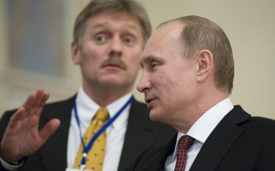 Dmitry Peskov and Vladimir Putin