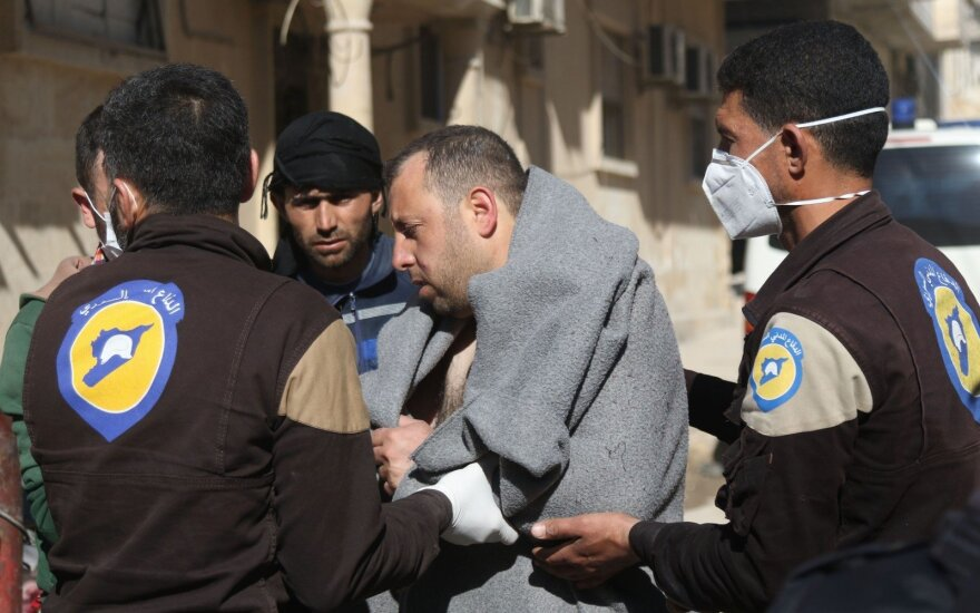Sirijoje įtariamos cheminės atakos aukų padaugėjo iki 86