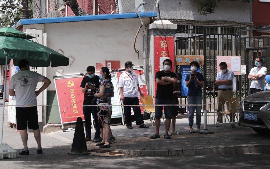 Kinijoje per parą išaiškinti 32 užsikrėtimo koronavirusu atvejai, kurių 6 yra besimptomiai