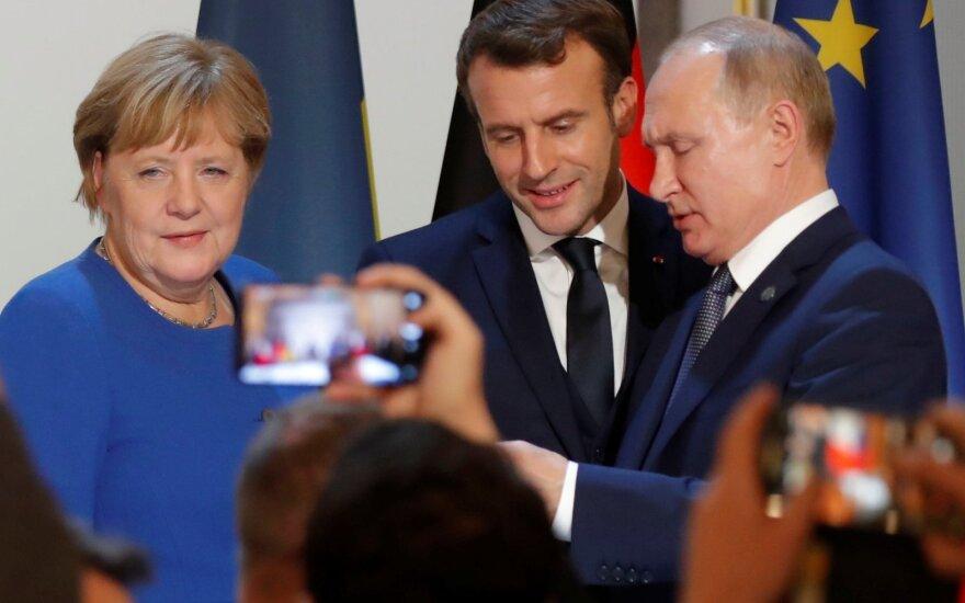 Angela Merkel, Emmanuelis Macronas, Vladimiras Putinas