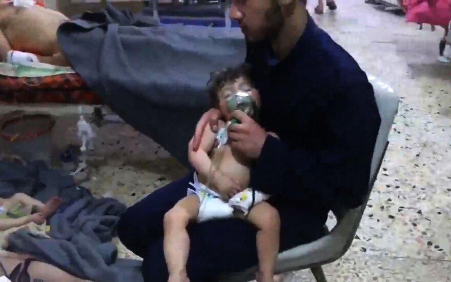 Theresa May: Assadas privalės atsakyti, jei bus patvirtinta informacija dėl cheminės atakos