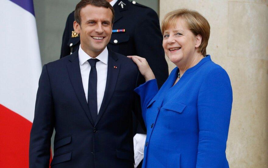 Nesutarimai dėl migrantų temdys Macrono ir Merkel derybas dėl ES