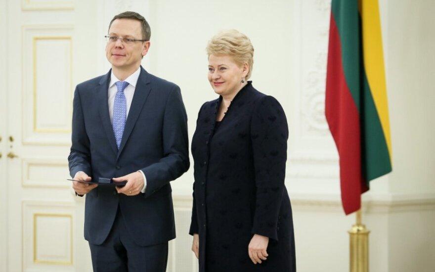 President Dalia Grybauskaitė (right) and her spokesman Modestas Naudžius