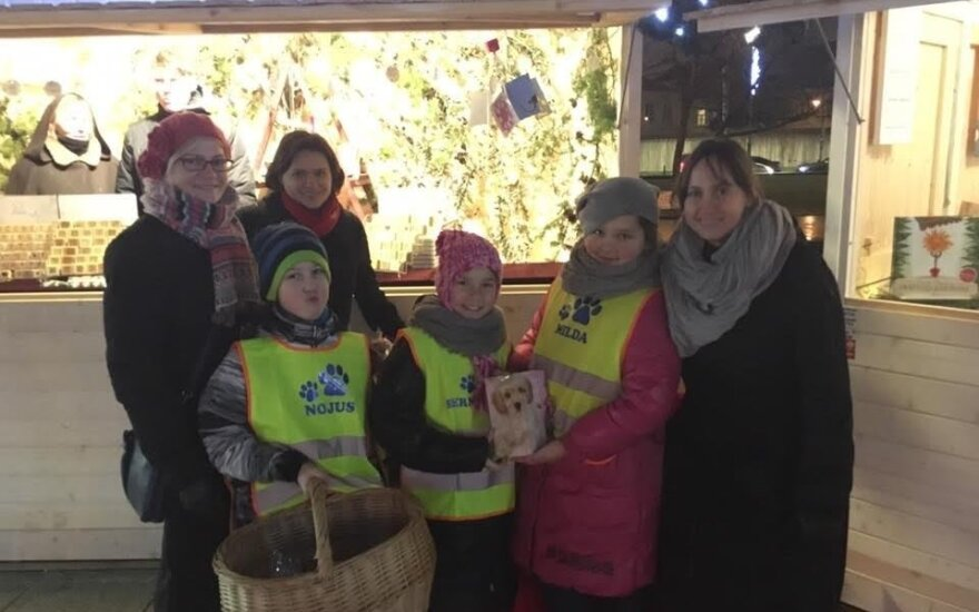 Children selling sweets to raise funds for an animal charity
