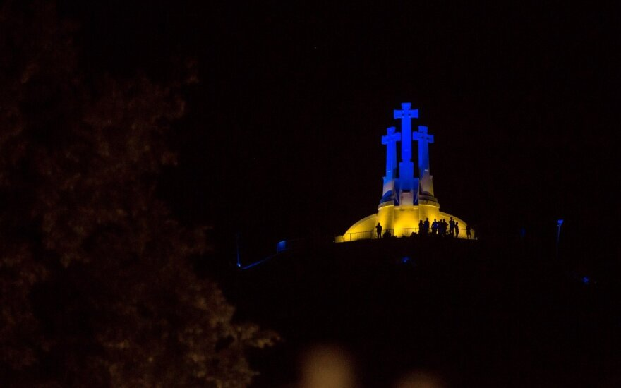 Three Crosses Hill lit with the colours of the Ukrainian flag