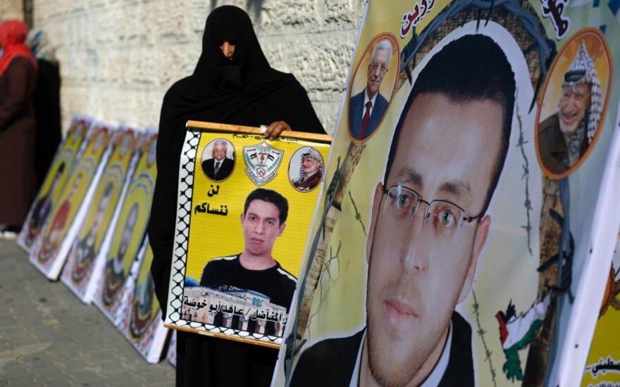 Palestinietė reikalauja išlaisvinti Mohammedą al-Qiqą