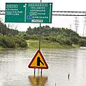 Vandens užlieti keliai