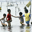 Filipiniečių vaikai ir žvejai
